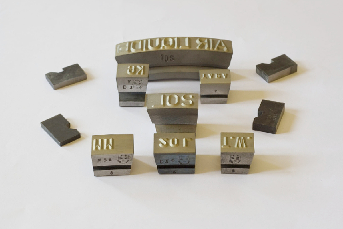composite metal stamps for marking machines